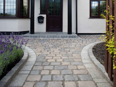 Norwich Paving Contractors Laying Cobblestones in Norwich